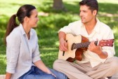 10190954-romantic-man-playing-guitar-for-his-wife