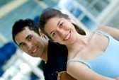 5940673-portrait-of-a-young-couple-at-the-gym-smiling